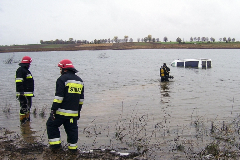 <p>Firemen stand in an artificial lake near the partly submerged van of a Polish driver who drove the vehicle into the water after following the instructions of his GPS unit on Oct. 23, 2008 in Glubczyce. The road, closed for over one year since being flooded by the creation of the lake, was taken by the driver who neglected to see three road signs before ploughing into the waters.</p>
