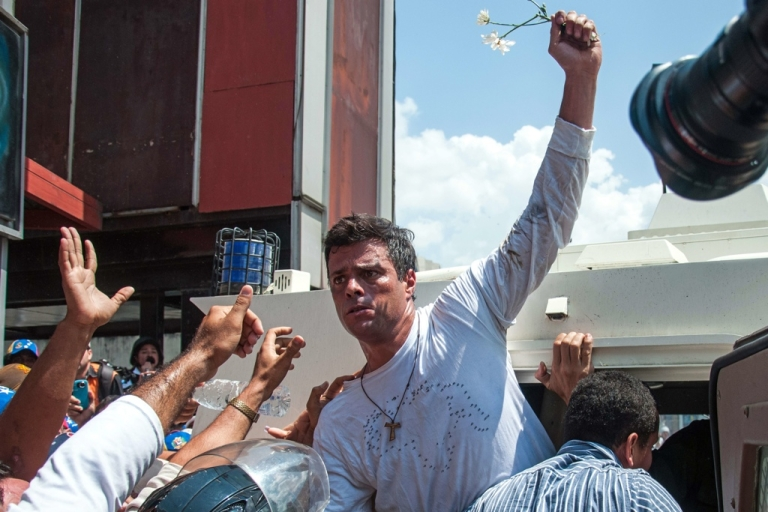 <p>Leopoldo Lopez, an ardent opponent of Venezuela's socialist government, turned himself in during a demonstration in Caracas Feb. 18.</p>
