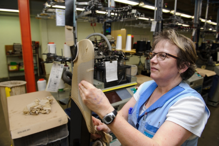 <p>An employee creates a sock at the Tricotage des Vosges factory in Vagney, eastern France.</p>