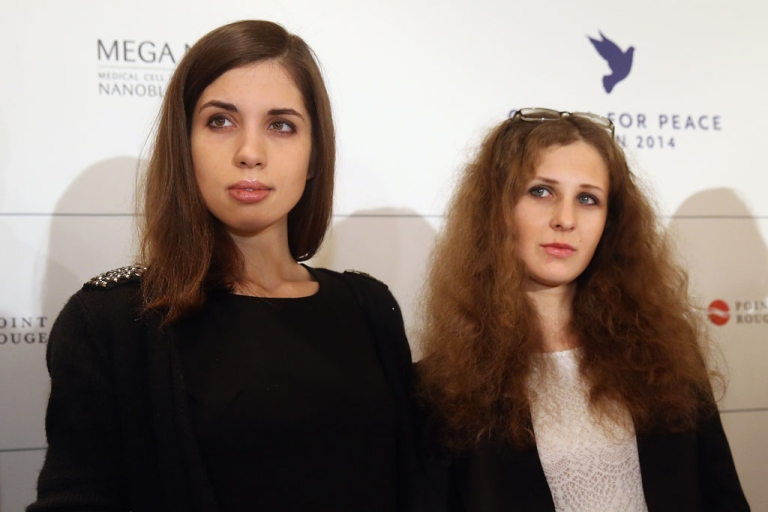 <p>Pussy Riot members Nadezhda Tolokonnikova (L) and Maria Alyokhina arrive to speak at the Cinema for Peace 2014 press conference at the Regent Hotel on Feb. 10, 2014 in Berlin, Germany.</p>