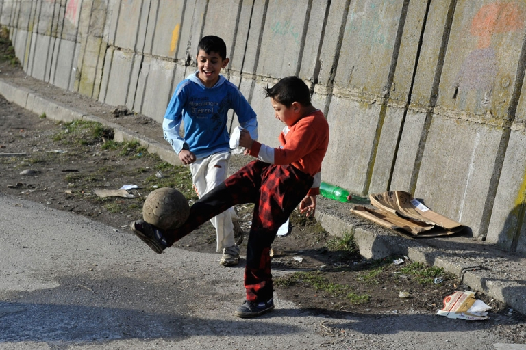 <p>Roma children play with a ball near their home in Brezno, central Slovakia on Feb. 5, 2014.</p>