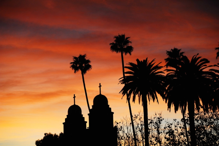 <p>A sunset is seen above the two steeples of Good Shepherd Catholic Church on December 11, 2010 in Beverly Hills, California.</p>