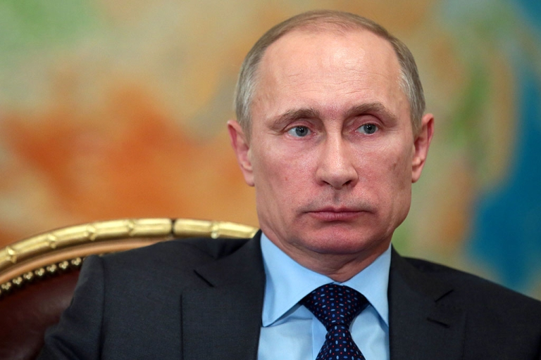 <p>Russia's President Vladimir Putin attends a meeting in his Novo-Ogaryovo residence, outside Moscow on Feb. 26, 2014.</p>