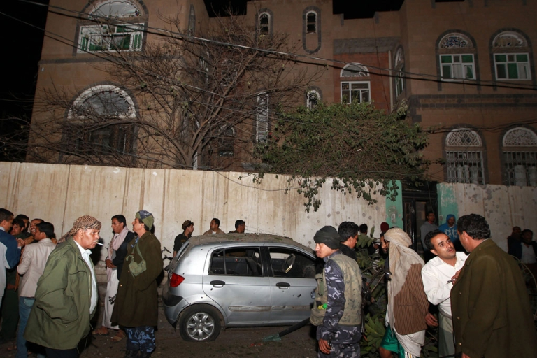<p>Yemeni soldiers and civilians gather at the site of an explosion near former president Ali Abdullah Saleh's house, which is close to the French embassy in Sanaa.</p>