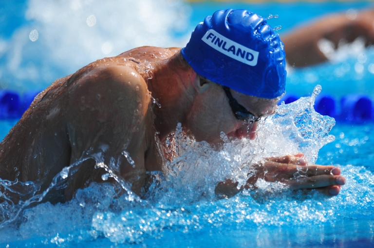 <p>Finland's Ari-Pekka Liukkonen competes during the men's 50m breaststroke qualifications at the European Swimming Championships in Budapest on August 13, 2010. Daniel Mihailescu/AFP/Getty Images</p>