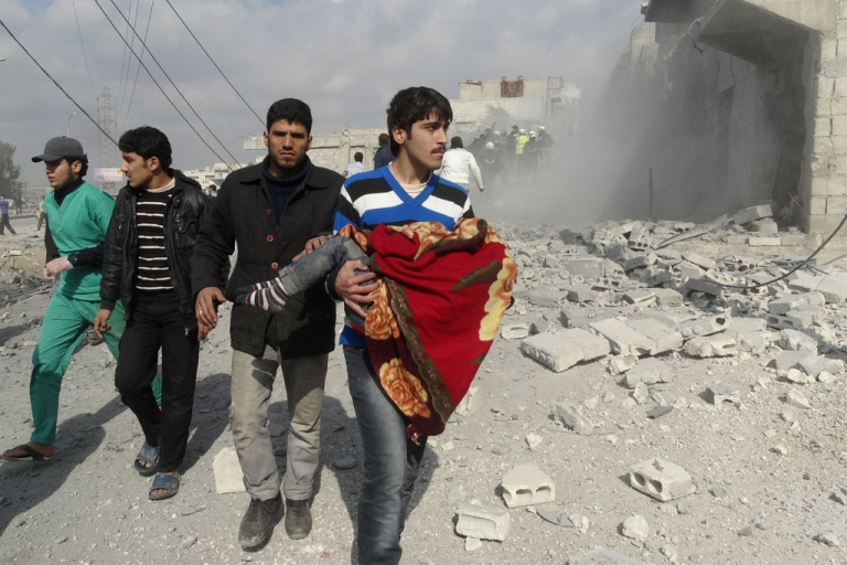 <p>A Syrian man carries a body following a reported air strike by government forces on the al-Haidarya neighborhood of the northern city of Aleppo on Feb. 11, 2014.</p>