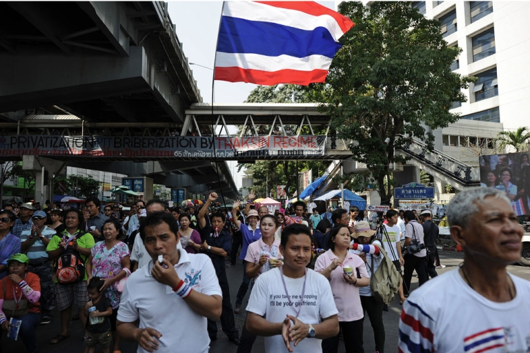 <p>Thai anti-government protesters listen to a leader's speech during a rally at a protest site in downtown Bangkok on February 4, 2014.</p>