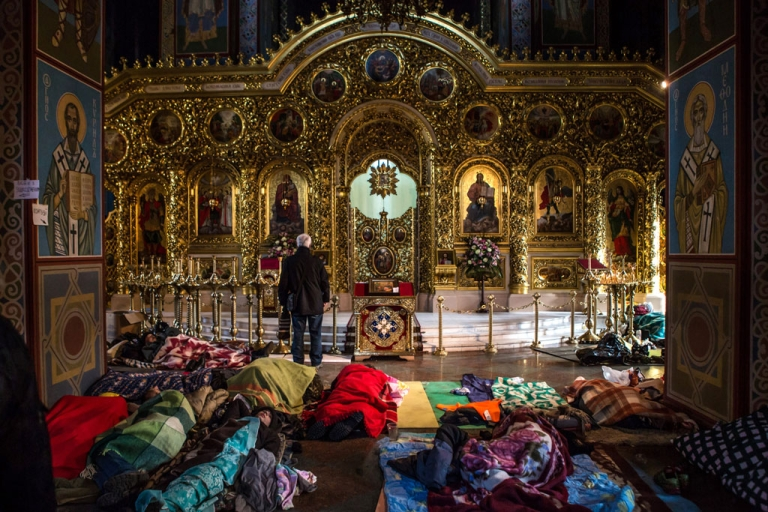<p>Anti-government protesters sleep on the floor inside the Mikhailovsky Monastery, which has been converted into a makeshift hospital, on Feb. 19, 2014 in Kyiv, Ukraine.</p>