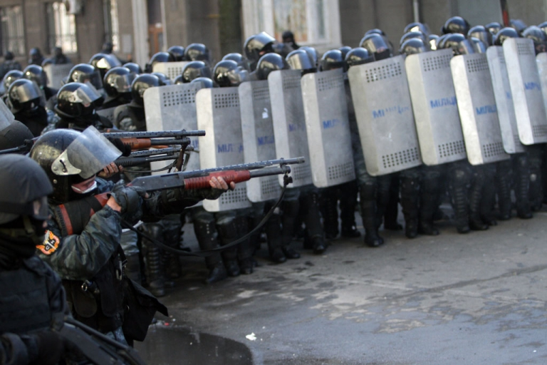 <p>Riot police aim at anti-government protesters during clashes in central Kiev on Feb. 18, 2014</p>