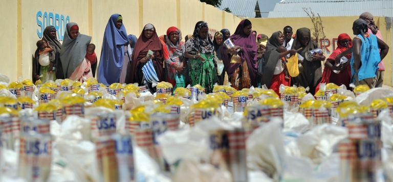 <p>US aid packages at a relief center in Mogadishu, Somalia in January 2012.</p>