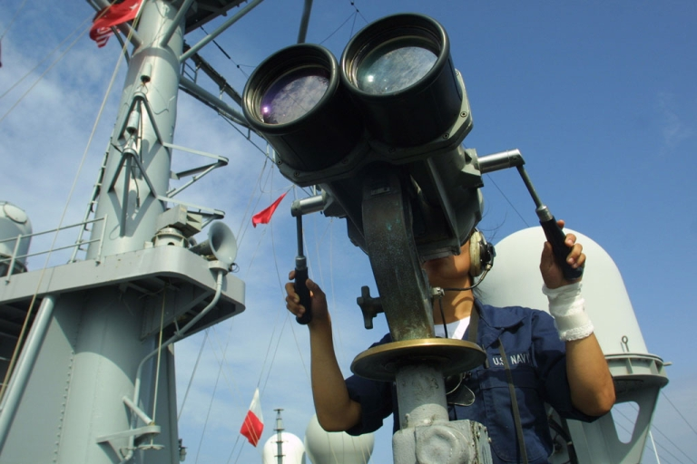 <p>A U.S. Navy sailor looks through binoculars from aboard the USS Mount Whitney on February 26, 2003 in the Gulf of Aden off the coast of Djibouti.</p>
