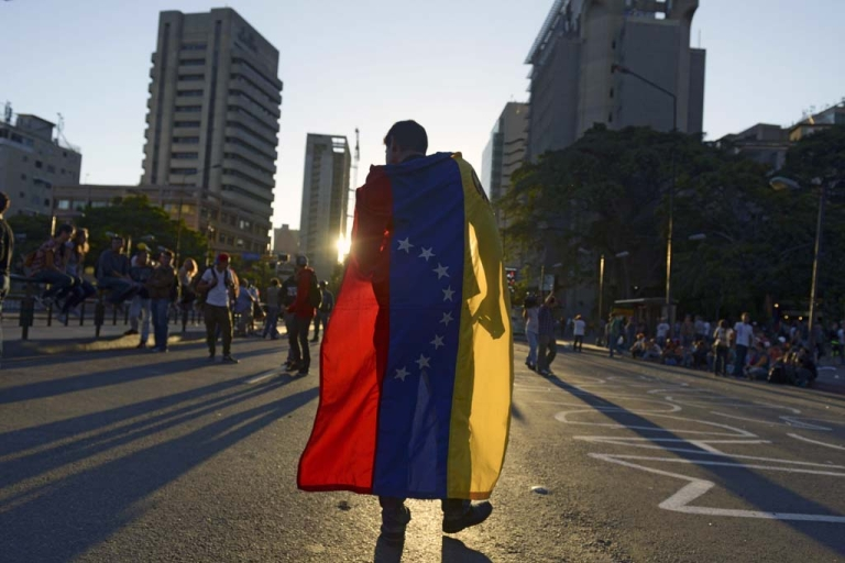 <p>People protest against the government of Venezuelan President Nicolas Maduro in Caracas, on Feb. 21, 2014.</p>