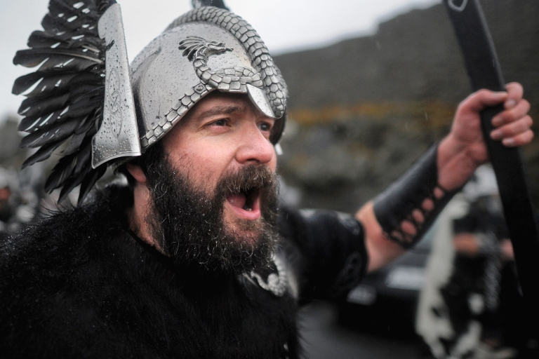 <p>Locals dressed as Vikings march through the streets of Lerwick on Jan. 28, 2014, in the Shetland Islands, Scotland.</p>