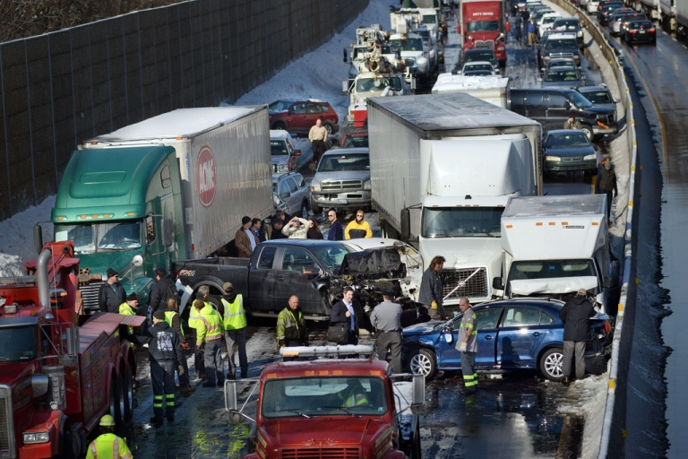 <p>Rescue crews assist at the scene of a 100-car pileup on the Pennsylvania Turnpike on February 14, 2014 in Feasterville, Pennsylvania.</p>