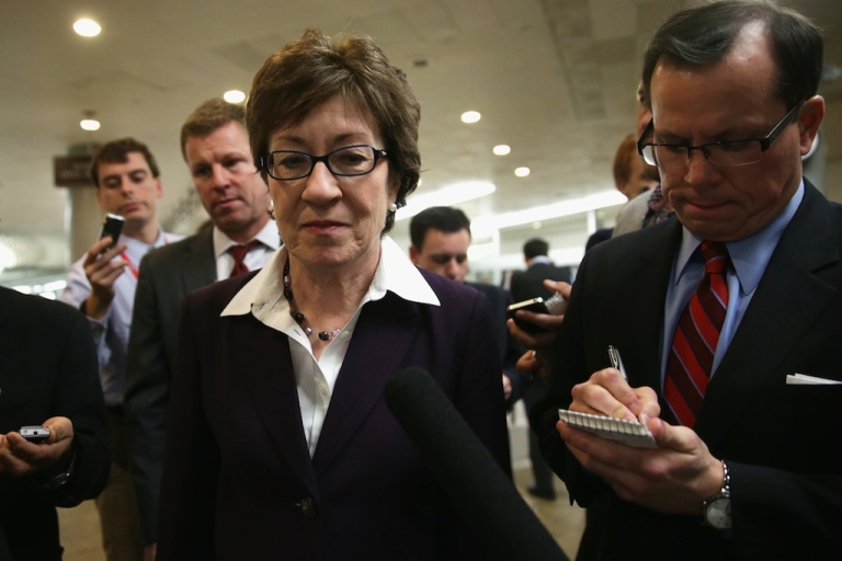 <p>US Sen. Susan Collins (R-ME) speaks to members of the press as she is on her way for a vote January 6, 2014 on Capitol Hill in Washington, DC.</p>