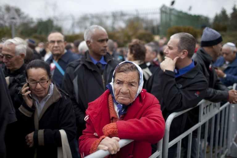 <p>An Israeli woman stands out side the Knesset (Israeli Parliament) to pay her last respects to Ariel Sharon on January 12, 2014 in Jerusalem.</p>