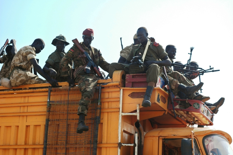 <p>Government soldiers prepare to deploy from the capital, Juba, as fighting continues to rage in south Sudan.</p>