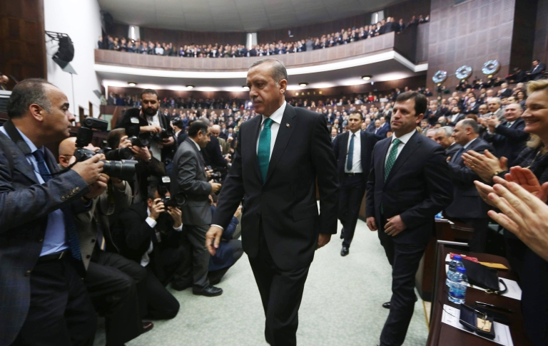 <p>Turkey's Prime Minister Recep Tayyip Erdogan arrives to deliver a speech to the members of the Turkish Parliament in Ankara on January 14, 2014. Erdogan said his government was ready to withdraw a contentious bill curbing the power of judges — on certain conditions.