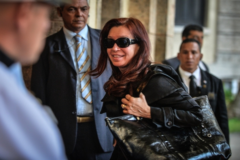<p>Argentine President Cristina Fernandez de Kirchner arrives at the National Hotel in Havana on January 25, 2014 where she will attend the II Summit of the Community of Latin American and Caribbean States (CELAC). The summit, to be held on January 28-29 in the Cuban capital, will bring together leaders and representatives of all nations from across the Americas (except the United States and Canada) with previous meetings starting on Saturday.</p>