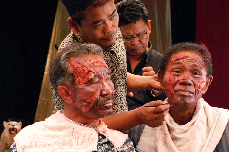 <p>Makeup art during the filming of