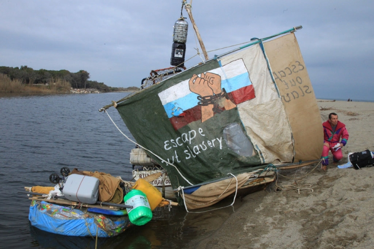 <p>Russian journalist Andrey Novoselov, fearing persecutions from President Vladimir Putin's regime, sits next to his raft on January 11, 2014, near Canet-en-Roussillon, France. Police prevented him from sailing to Spain and the United States in search of political asylum.</p>