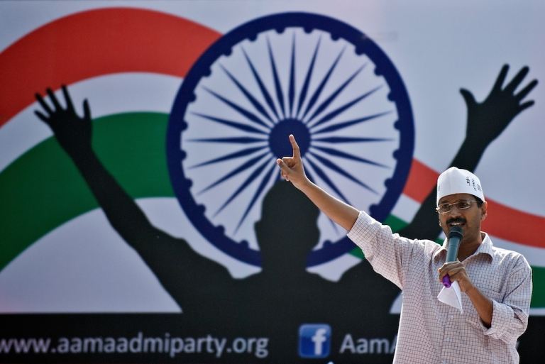 <p>Activist turned politician Arvind Kejriwal gestures at a rally of the