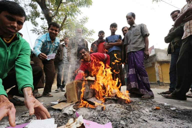 <p>Bangladeshi protestors burn election material at a polling station in the northern town of Bogra on January 5, 2014. Protestors firebombed polling stations and attacked police as Bangladesh went ahead with a violence-plagued election boycotted by the opposition.</p>