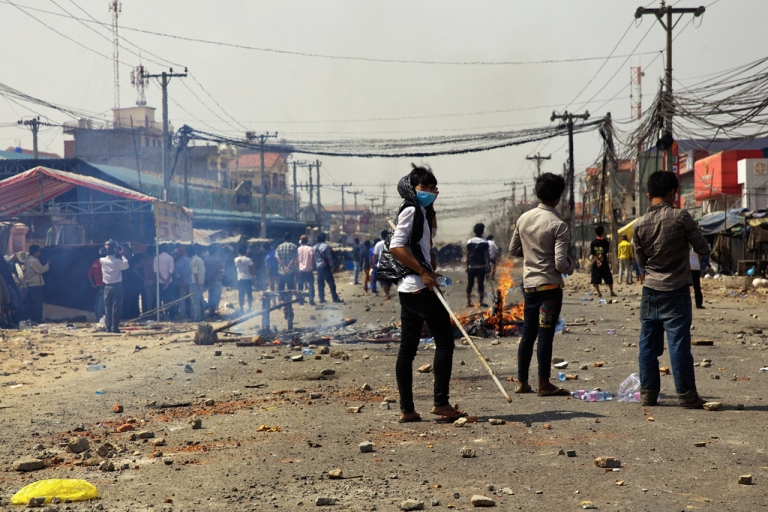 <p>Protesters clash with police on January 3, 2014 in Phnom Penh, Cambodia. At least three were reported killed.</p>
