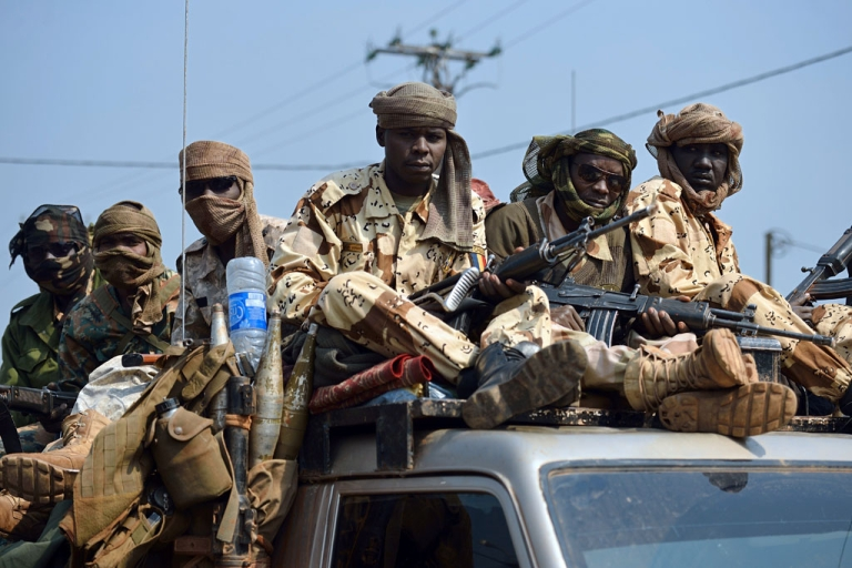 <p>Chadian troops of the African-led International Support Mission to the Central African Republic (MISCA) patrol following the resignation of the Central African Republic president in Bangui on January 10, 2014. Michel Djotodia stepped down under regional pressure after failing to stem sectarian violence ripping his country apart.</p>