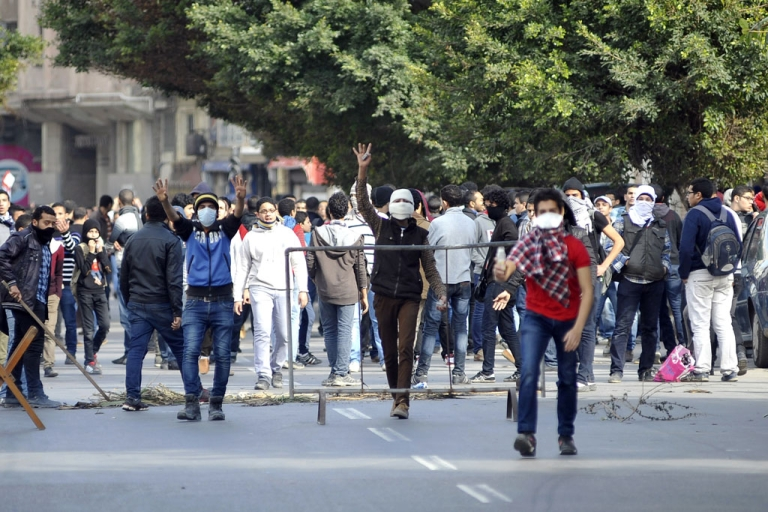 <p>Egyptian protesters and supporters of the Muslim Brotherhood chant slogans during clashes with Egyptian police in the northern port city of Alexandria on January 23, 2014.</p>