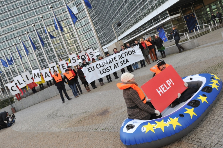 <p>Activists demonstrate in support of climate objectives at the European Commission headquarters on January 22, 2014 in Brussels.</p>