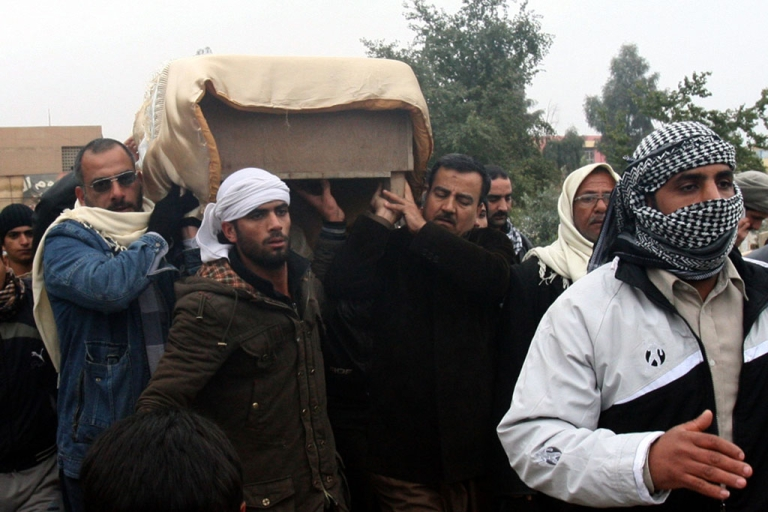 <p>The coffin of a man killed in fighting is carried for burial in the western Iraqi city of Fallujah, Anbar province, Jan. 4, 2014.</p>