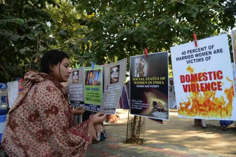<p>This photo taken on Dec. 16, 2013, shows an Indian woman attending an exhibition commemorating the one-year anniversary of the deadly gang rape of a 23-year-woman in New Delhi.</p>