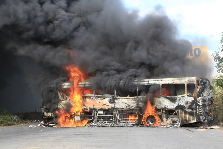 <p>A burning bus in Paracuaro, in Mexico's western Michoacan state, was one of the stark signs of anger against the so-called self-defense militias.</p>
