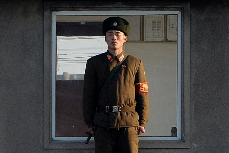 <p>A North Korea soldier stands guard on the banks of the Yalu River which separates the North Korean town of Sinuiju from the Chinese border town of Dandong, Dec. 17, 2013.</p>