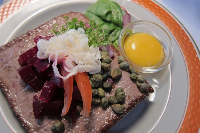 <p>Classic smørrebrød: ground beer patty, capers, picked beets, cress, fresh horseradish and a raw egg yolk.</p>