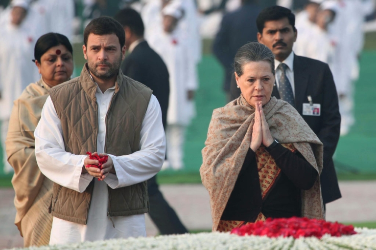 <p>Chairperson of India's Congress-led UPA government, Sonia Gandhi (R) with her son, Congress Party Vice President, Rahul Gandhi (L) in New Delhi on November 14, 2013.</p>