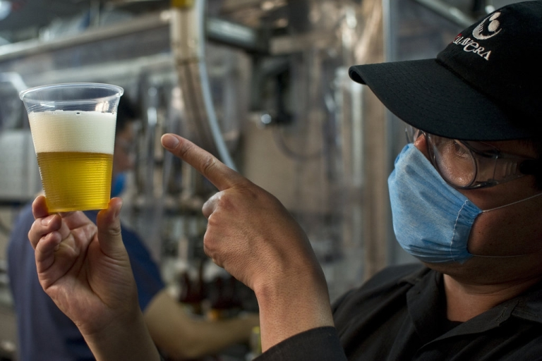 <p>Employee Angel Rodriguez checks the beer during the bottling process in the Cervecería Calavera, on July 20, 2012, in Tlanepantla, Mexico State. Producers of handcrafted beer are making their way in Mexico following the emergence of new breweries in crowded neighborhoods of the capital and as large emporiums producing traditional brands like Corona stopped being Mexican-owned.</p>