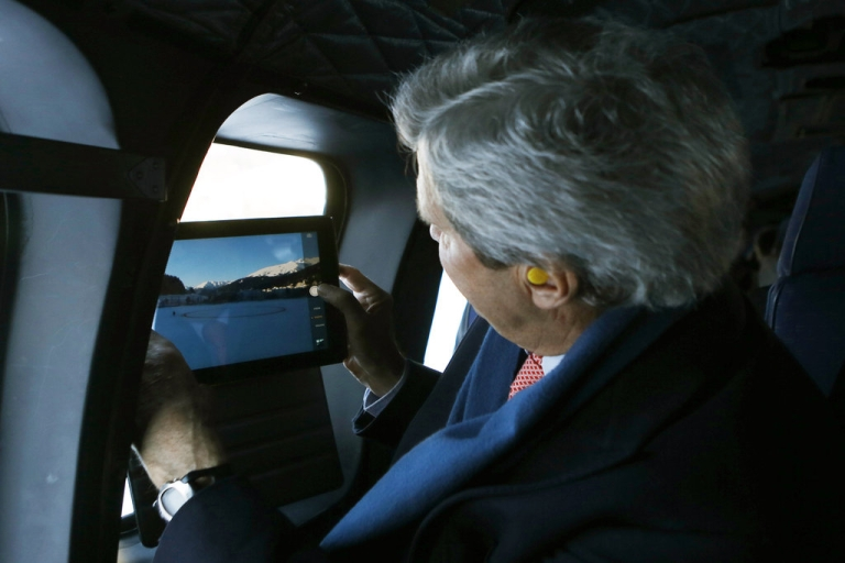 <p>US. Secretary of State John Kerry takes photographs of the Swiss Alps during a helicopter ride from Davos to Zurich on January 25, 2014. Kerry is returning to the US from the Syrian Peace Talks and the World Economic Forum.</p>