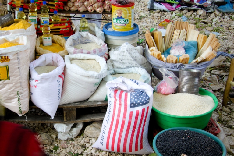 <p>Sacks of American rice for sale at a Port-au-Prince market.</p>