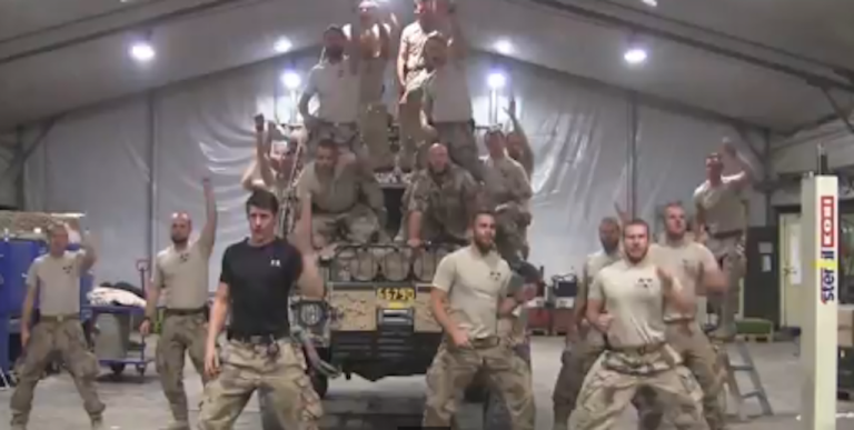 <p>This screengrab from YouTube shows a group of Swedish Marines dance and sing