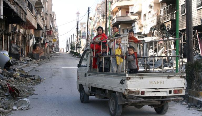 <p>A family flee Maarat al Numan in January 2013.</p>