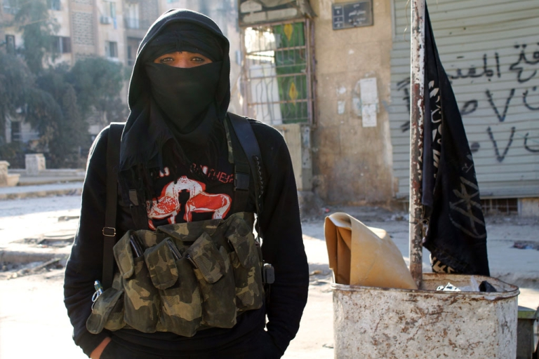 <p>A member of the Al-Nusra Front jihadist group stands in the northern Syrian city of Aleppo on January 11, 2014. Fighting pitting the Islamic State of Iraq and the Levant (ISIL) against other rebel groups, including the Al-Nusra Front, which is also linked to Al-Qaeda but is seen as more moderate, broke out in Syria last week.</p>