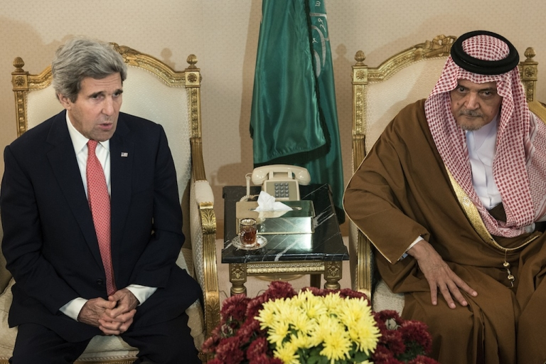 <p>Saudi Foreign Minister Prince Saud al-Faisal bin Abdulaziz al-Saud listens as US Secretary of State John Kerry makes a statement to journalists at King Khalid International Airport in Riyadh on Jan. 5, 2014. Both countries are opposed to Iran attending this week's Syria peace conference.</p>