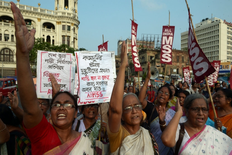 <p>Indian activists from the Social Unity Center of India (SUCI) shout slogans against the state government in protest against the gang-rape and murder of two girls in the district of Badaun in the northern state of Uttar Pradesh and recent rapes in the eastern state of West Bengal, in Kolkata on June 7, 2014. The protests came amid a growing uproar over the killings in Uttar Pradesh, with the United Nations saying violence against women should be regarded as a matter of basic human rights. The two cousins, aged 14 and 12, were found hanging from a mango tree in their impoverished village, with subsequent tests showing they had been the victim of multiple sexual assaults.</p>