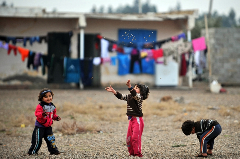 <p>Syrian children play in a refugee camp in Reyhanli.</p>