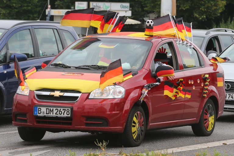 <p>German flags are placed on a car on July 9, 2014 in Berlin.</p>