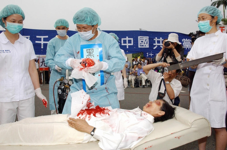 <p>During a Falun Gong rally in Taiwan in 2006, four demonstrators play in an action drama against what they said was the Chinese communists' killing of Falun Gong followers and harvesting of their organs in concentration camps. China recently placed the outlawed group at the top of its list of terrorist organizations, despite no history of violence against others.</p>