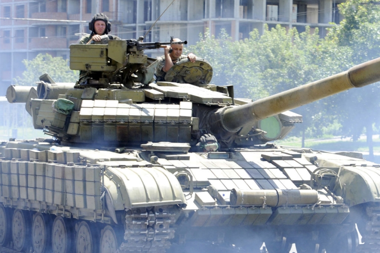 <p>Pro-Russian militants drive a tank in the eastern Ukrainian city of Donetsk on July 21, 2014.</p>