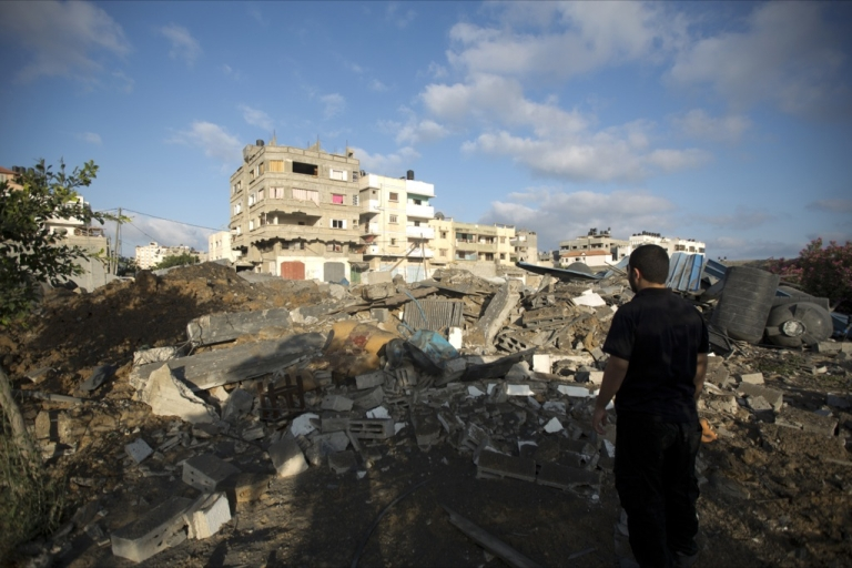 <p>A Palestinian man inspects damage after overnight Israeli air strikes on July 3, 2014 in Gaza City.</p>